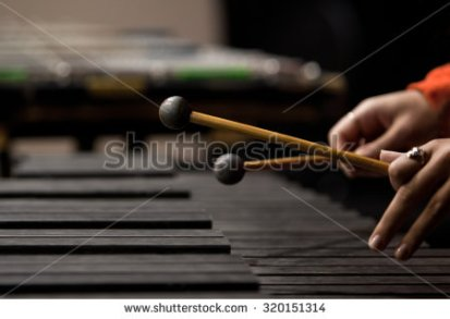 stock-photo-drum-sticks-striking-the-xylophone-in-close-up-in-dark-colors-320151314